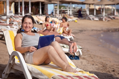 Woman laptop beach